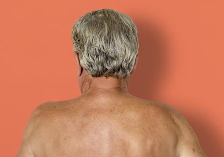 Man shirtless rear view studio portrait Stock Photo