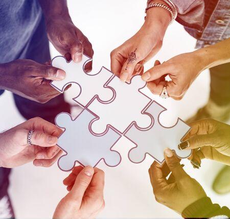 Human hands holding jigsaw together Reklamní fotografie