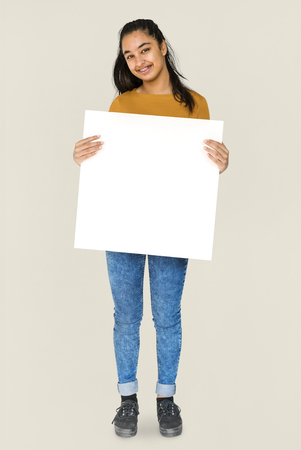 hilarious: Indian Ethnicity Smiling Girl Standing and Holding Placard