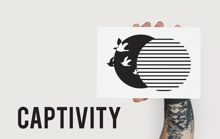 Graphic of bird unleashed from captivity to freedom Reklamní fotografie - 80417094