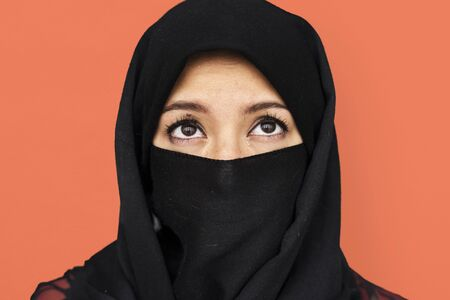 Middle eastern woman in hijab studio portrait Stock Photo