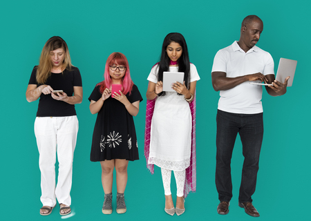 Group of people using digital devices technology