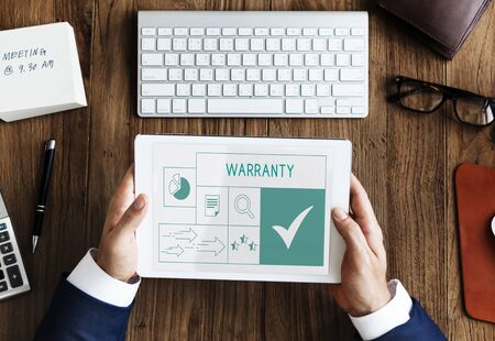 Illustration of quality product warranty assurance on digital tablet 版權商用圖片