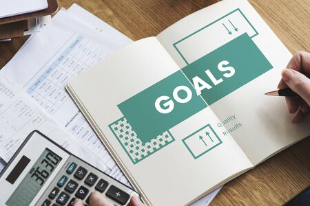 Business goals target process on notebook Фото со стока