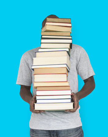 exhausting: African Man Carrying Textbook School Education