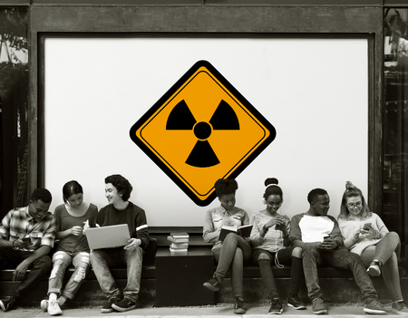 Group of Friends Sitting Together with Propeller Attention Banner Behind Stock Photo