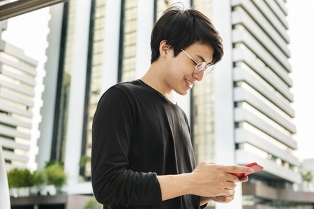 Asian man using mobile phone connection technology