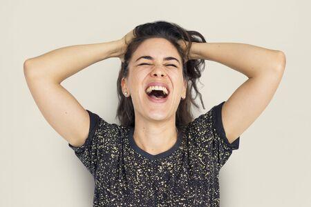 Studio portret van een jonge vrouw die frustratie uitbeeldt Stockfoto - 80574923
