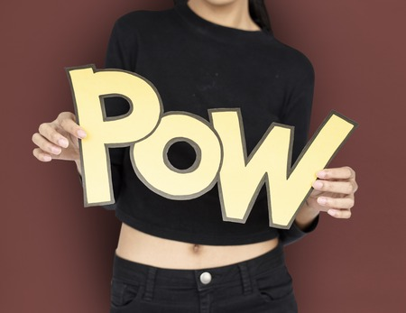 Woman holding paper word pow