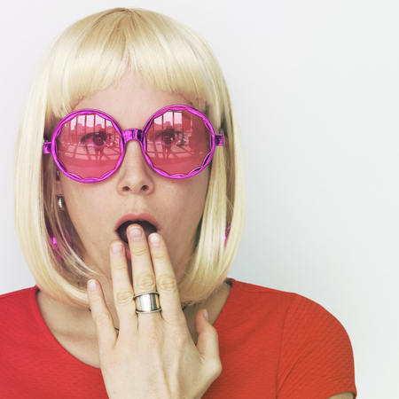 adult oops: Woman Wearing Blonde Hair Wig Surprise Face Expresssion Studio Portrait Stock Photo