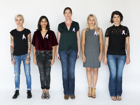 testicular: Group of Diverse People with Purple Ribbon Represent  Cancer Survivor Stock Photo