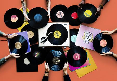 Hands holding vinyl records Imagens