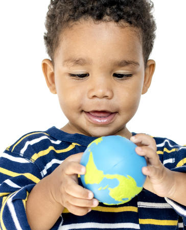 Happiness african little boy smiling and playing with globe Stock Photo