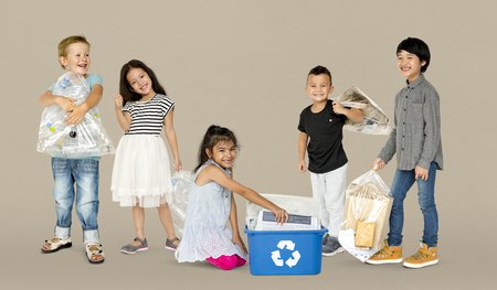 Diverse Group Of Kids Recycling Garbage Stock Photo