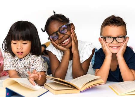 Group of school kids reading for education 版權商用圖片