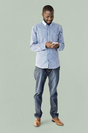African Descent Man is using Smartphone Stock fotó