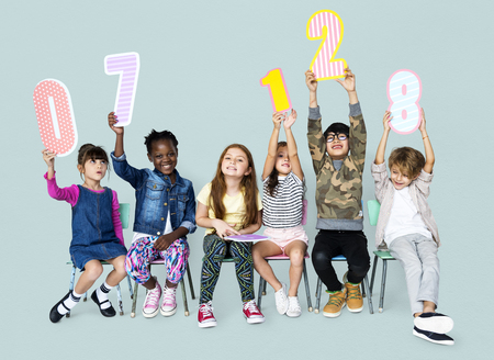 A group of children are holding a number Stock Photo