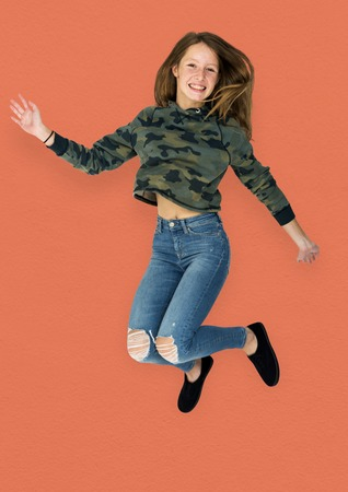 Young Adult Woman Jumping Studio Portrait