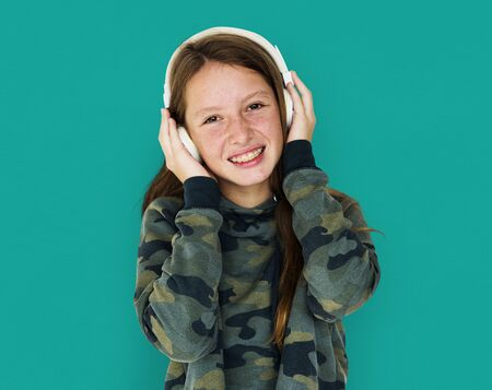 entertaining: Young Adult Woman with Headphone Listen Music Studio Portrait
