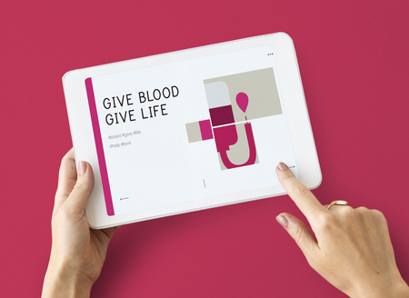 Illustration of blood donation campaign on digital tablet Stock Photo