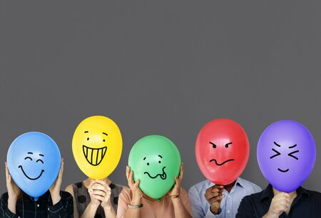 Group of people holding balloon express their emotion Stock Photo