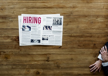 Career Hiring Job Announcement on Newspaper Stock Photo