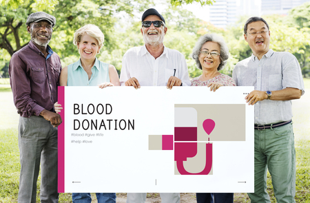 Group of senior adult holding banner of blood donation campaign Banco de Imagens