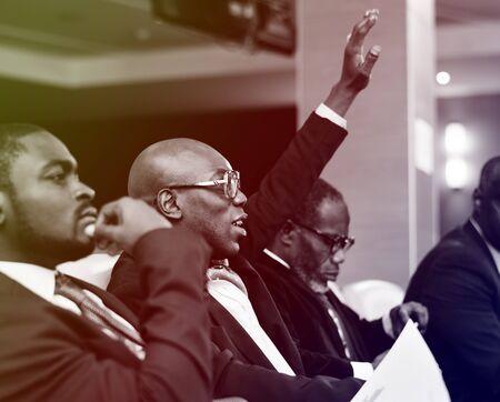 国際会議でのプレゼンテーションを聴き入る聴衆 写真素材
