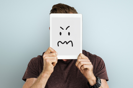 impressed: Young man holding a tablet with handdrawn expression
