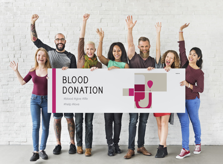 Group of people holding banner of blood donation campaign