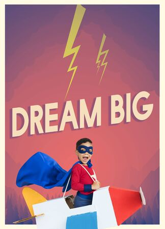 yourself: Superhero kid boy with paper plane toy and aspiration word graphic