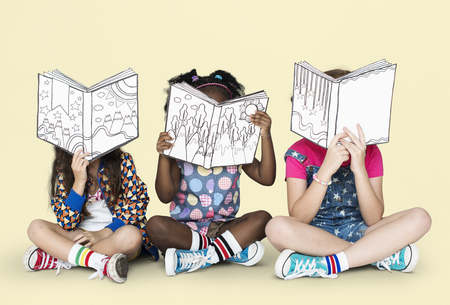 Little Children Reading Story Books Imagens