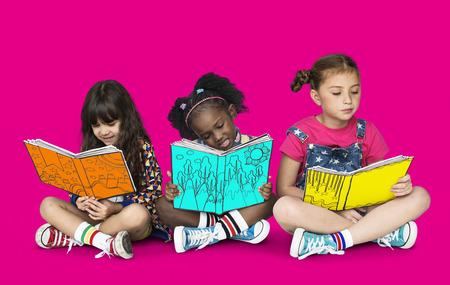 Children Girlfriends Reading Book Education Togetherness Studio Portrait