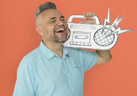 Caucasian Man Holding Paper Crafted Jukebox Banco de Imagens - 80708672