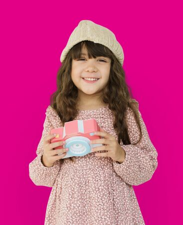 beanie: Little Girl Smiling Happiness Paper Craft Arts Camera Photographing Studio Portrait