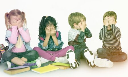 Group of little kids playing peek-a-boo together Banco de Imagens - 80772971