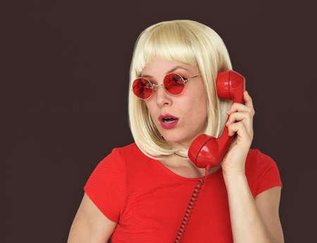 Caucasian Blonde Woman Answering Phone Stock Photo