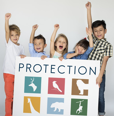 species living: Young kids holding a save the animals banner