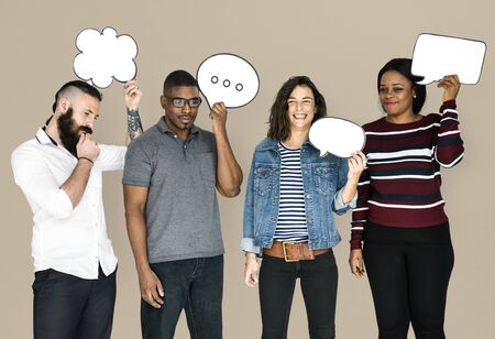 People Holding Chat Bubbles Smiling Stock Photo