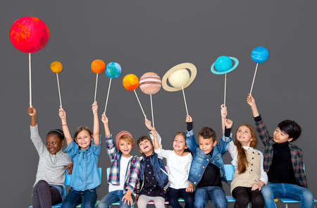 hilarious: Happy Diverse group of kids holding planets