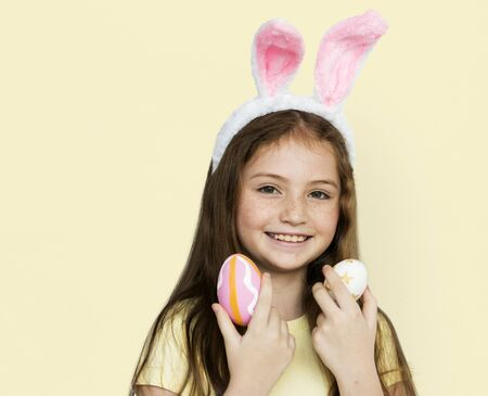 Children with bunny hairband and easter eggs Stock Photo