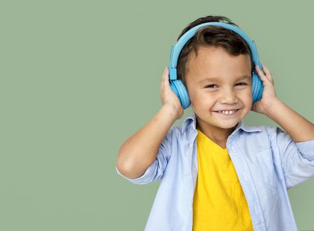 earbud: Boy Listening Music Studio Concept