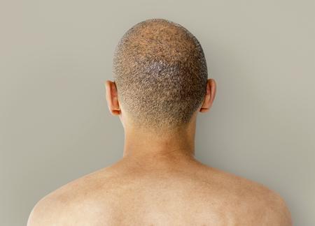 skinhead: A Man Back View with Skinhead