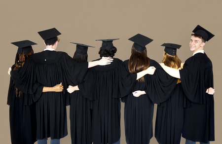 Diverse Students wearing Cap and Gown Studio Portrait Stock Photo