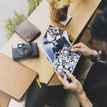 Photographing editor choosing photo at cafe Banco de Imagens - 80718338