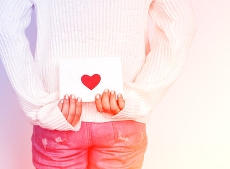 Love envelop is on hands. Stock Photo