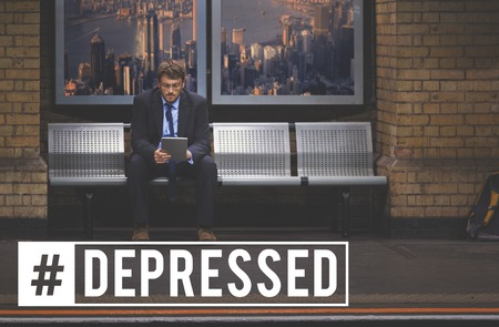 Man sitting at a subway with depressed concept