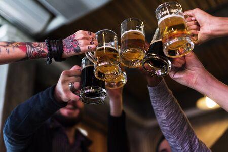 drinks after work: Hands Hold Beverage Beers Bottle Cheers
