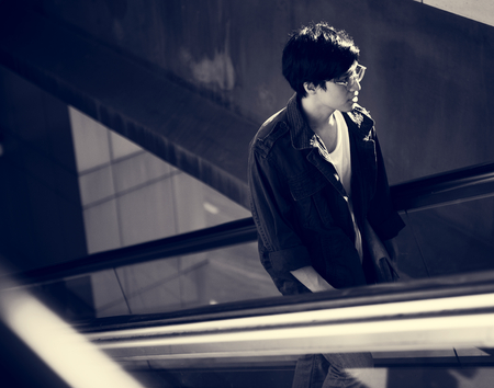 Young asian using escalator routine life