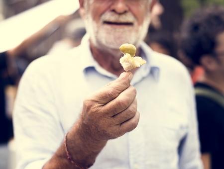 Senior Adult Man Showing Bread with Preserve Olive Sample Test Reklamní fotografie